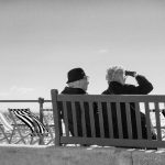 two older people on a bench